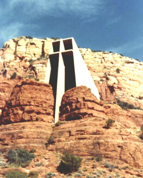 The Chapel of the Holy Cross towers above sandstone formations.